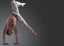 Sporty young man doing gymnastic exercise Royalty Free Stock Images