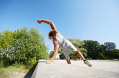 Sporty young man jumping in summer park Stock Images