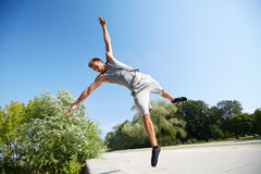 Sporty young man jumping in summer park Stock Photography