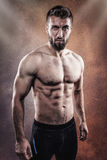 Sporty young man with Six Pack. And beard Stock Photos