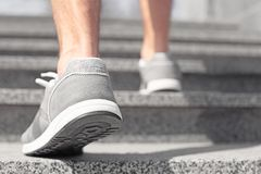 Sporty young man in training shoes outdoors. Closeup royalty free stock photography
