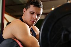 Sporty young man work out biceps Stock Photography