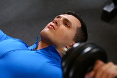 Sporty young man work out chest Royalty Free Stock Photos