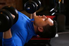 Sporty young man work out chest Stock Photo