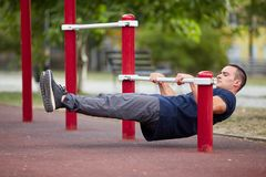 Active life and sport concept. Work out male. Athletic body. Sporty young man working out at early morning male jogger exercising, runner working out outdoors Royalty Free Stock Photos