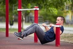 Active life and sport concept. Work out male. Athletic body. Sporty young man working out at early morning male jogger exercising, runner working out outdoors Royalty Free Stock Photo