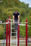 Active life and sport concept. Work out male. Athletic body. Sporty young man working out at early morning male jogger exercising, runner working out outdoors Stock Photos
