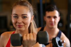 Sporty young smiling couple work out together Royalty Free Stock Photography