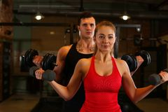 Sporty young smiling couple work out together Stock Photography