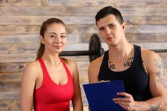 Sporty young smiling couple work out together Royalty Free Stock Image