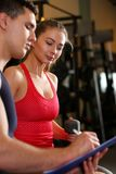 Sporty young smiling couple work out together. Stock Images