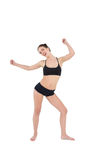 Sporty young woman dancing isolated on white background Stock Image