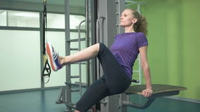 Sporty young woman doing exercise at the gym stock video footage