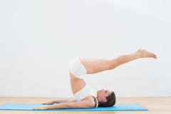 Sporty young woman doing the plough posture Stock Photo