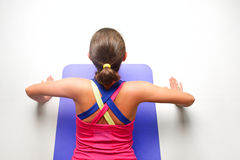 Sporty young woman doing push-ups in gym. Stock Photo
