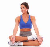 Sporty young woman doing relaxation exercise Stock Photo
