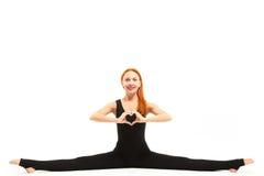 Sporty young woman doing splits yoga asana Stock Image