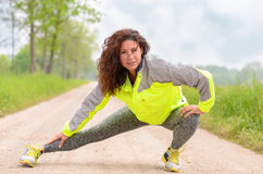 Sporty young woman doing stretching exercises Stock Image