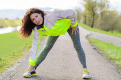 Sporty young woman doing stretching exercises Royalty Free Stock Photo