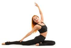 Sporty young woman doing yoga asana Stock Photos