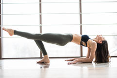 Sporty young woman doing yoga practice Royalty Free Stock Image