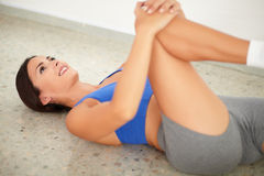 Sporty young woman doing yoga for relaxation Royalty Free Stock Images