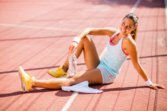 Sporty young woman drinking water Stock Image