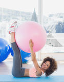 Sporty young woman with exercise ball in fitness studio Royalty Free Stock Images