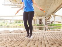 Fitness woman jumping rope outdoor royalty free stock photo