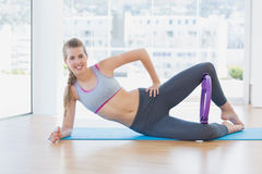 Sporty young woman with exercising ring in fitness studio Stock Photo