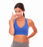 Sporty young woman gesturing phone call Stock Photography