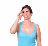 Sporty young woman having a headache Stock Images