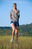 Sporty young woman jogging Stock Image