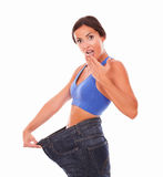 Sporty young woman looking surprised on body shape Royalty Free Stock Image