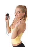 Sporty young woman with mp3 player. Royalty Free Stock Images