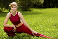 Sporty young woman outdoors Stock Photos