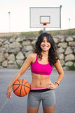 Sporty young woman playing basket outside Royalty Free Stock Photography
