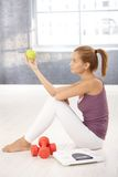 Sporty young woman posing with apple Stock Image