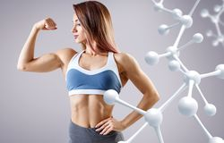 Sporty young woman posing near molecules structure. stock photography