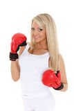 Young woman in fighting gloves Royalty Free Stock Photography