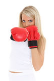Young woman in fighting gloves Stock Images