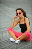 Sporty young woman resting on the beach Stock Photography