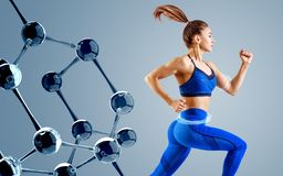Sporty young woman runing and jumping near glass molecules. stock photo