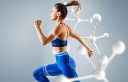 Sporty young woman runing and jumping. Sporty young woman runing and jumping near molecules. Metabolism concept stock photos