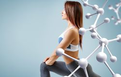 Sporty young woman running and jumping near molecules structure. royalty free stock photo