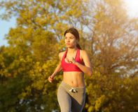 Sporty young woman running outdoors. Portrait of a sporty young woman running outdoors Stock Images