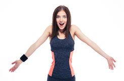 Sporty young woman shrugging her shoulders. Sporty young surprised woman shrugging her shoulders isolated on a white background. Looking at camera Royalty Free Stock Photography