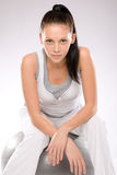 Sporty young woman sitting on fitness ball Stock Photo