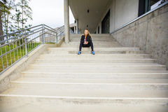 Sporty Young Woman Sitting On Steps After Workout Royalty Free Stock Photo
