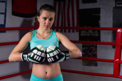 Sporty young woman in sportswear and in boxing gloves training Stock Image